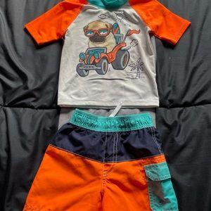 Baby boys matching swim shirt and trunks.